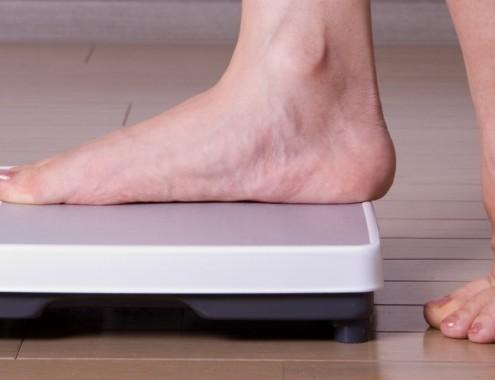 invloed gewicht op migraine